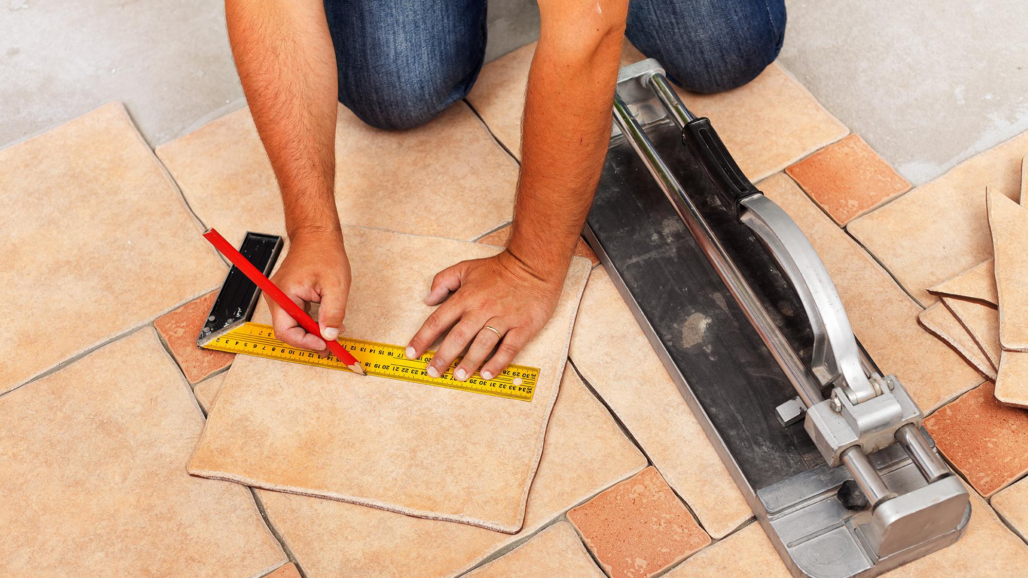 man installing tile